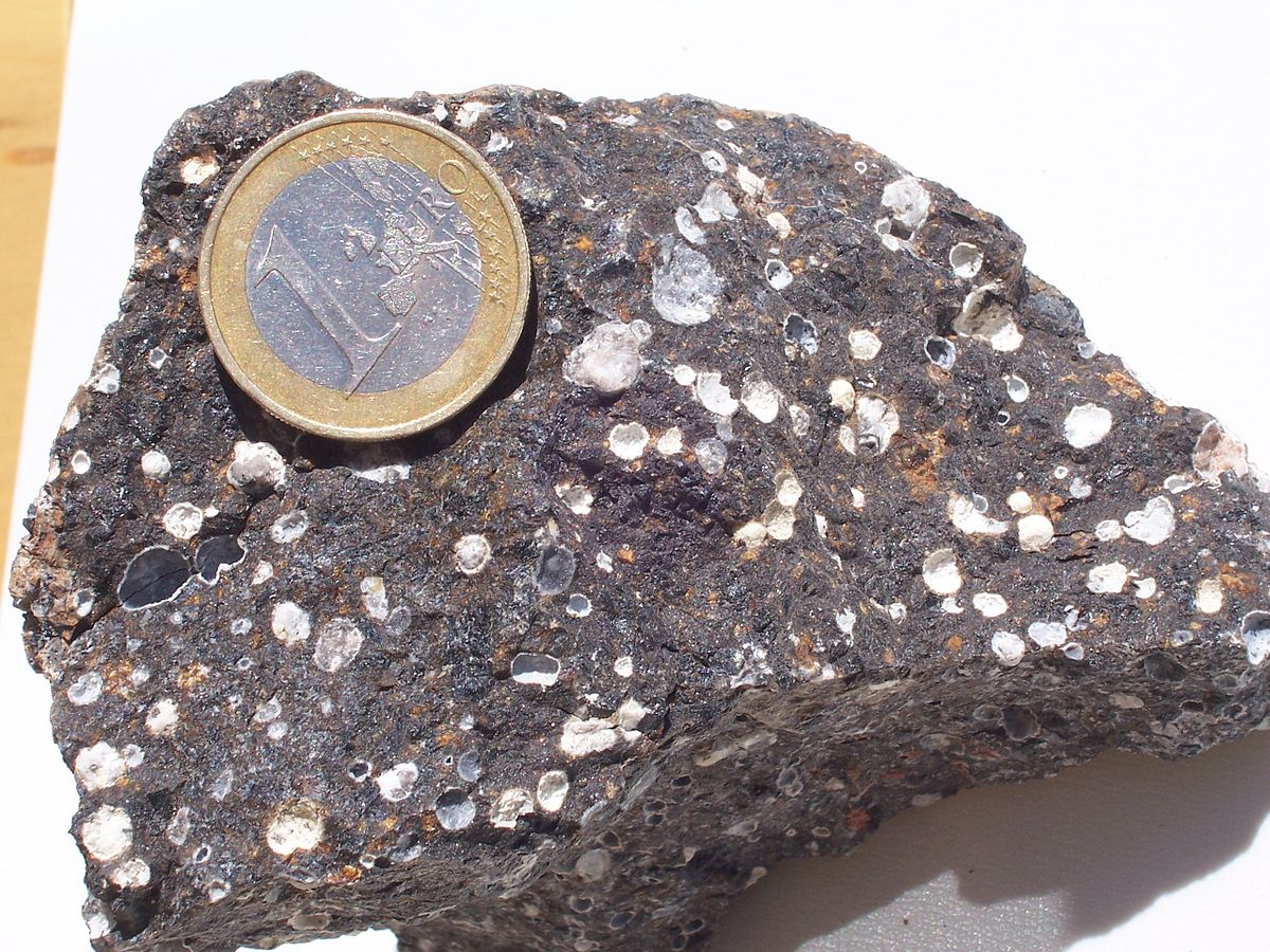 What is an an igneous rock that contains vesicles?