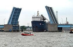 Veterans Memorial Bridge (Bay City, Michigan) opened for freighter, view from river.jpg