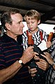 Vice President Bush visits with a young supporter during a campaign reception in Dallas, TX.jpg
