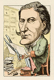Drawing of a man with a large head, seated facing the viewer, wearing a pale green coat and cutting up a printed sheet of paper with large scissors