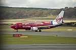 Virgin Blue (VH-VBJ) Boeing 737-7Q8 taking off on the main runway at Canberra Airport (1).jpg