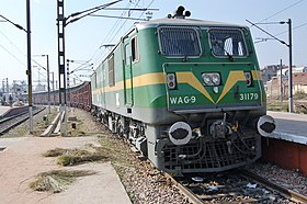 n locomotive class wag 9 n railways wag 9 class ac electric locomotive no 31179 pauses at agra fort railway station n railways station code af at the head of a heavily
