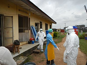 Isolation (health care) - Isolation wards may need to be hastily improvised during epidemics such as in this image of WHO workers in Lagos, Nigeria managing Ebola patients in 2014.