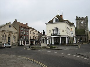 The Corn Exchange (left), the war memorial (centre), the Town Hall (centre-right) and St Mary-le-More church (right)