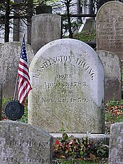 Irving's grave, marked by a flag, in Sleepy Hollow Cemetery, Sleepy Hollow, New York.