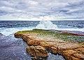 Waves crashing over Moes Rock at Jervis Bay Marine Park.jpg