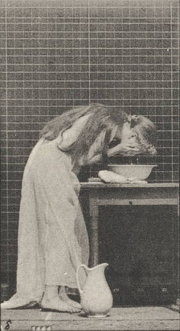 Woman brushing hair and washing face (rbm-QP301M8-1887-496a~8)