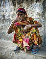 Woman in a colourful sari, Rajasthan (6358630335).jpg