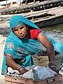 Woman with Coals - Varanasi - Uttar Pradesh - India (12479946975).jpg