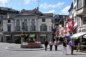 Augustinergasse - Münzplatz and Folderbrunnen, Augustinerkirche to the left, Augustinergasse to the right