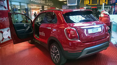 """ 15 - ITALY - Fiat 500X rear views red urban compact SUV with open doors.jpg"