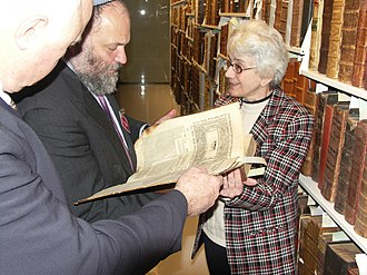 American Bible Society - Israel MK Effie Eitam reviewing a 16th-century Hebrew Bible at the American Bible Society's Bible Library with Dr. Lupas