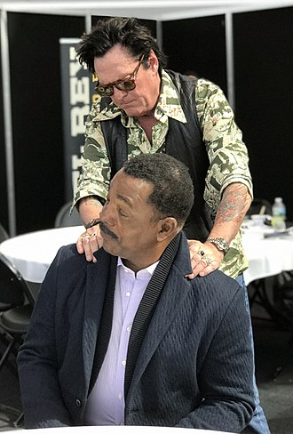 Michael Madsen - Madsen horsing around with co-star Carl Weathers while promoting Explosion Jones at the 2017 New York Comic Con