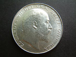 George William de Saulles - Obverse of a 1905 Edward VII halfcrown showing George William de Saulles' initials underneath the king's bust.