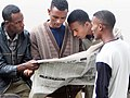2004 reading newspaper Addis Ababa Ethiopia 91389965.jpg