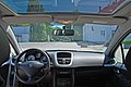 2010 Peugeot 207 Urban Move white 2dr interior front incl glass roof top.jpg