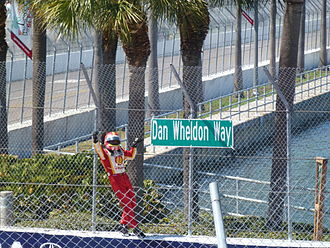 2012 Honda Grand Prix of St. Petersburg - Hélio Castroneves stopped on Dan Wheldon Way (Turn 10) victory lap after winning the 2012 Honda Grand Prix of St. Petersburg to pay respects to the sign honouring the late resident of the city, a two-time Indianapolis 500 champion.