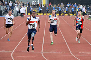 Invictus Games - Four runners from Germany, the United Kingdom and the United States during a 100-metre qualifying heat at the 2014 Invictus Games