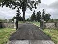 2018-09-10 15 01 40 View north along the road entering Finn's Point National Cemetery, the westernmost road in New Jersey, in Pennsville Township, Salem County, New Jersey.jpg