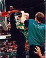 240896 - Atlanta Games men's basketball Troy Sachs cuts down the net - 3b - Scan.jpg