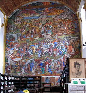 Princess Eréndira - In the early 1940s the former St. Augustine temple was turned into a public library. Juan O'Gorman painted a graphic history of Michoacán right where the altar used to be. Princess Eréndira is riding the white horse on the left side of the painting.