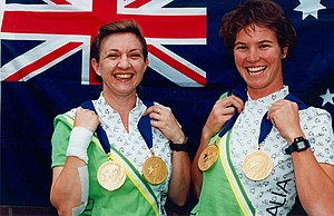 Cycling at the 1996 Summer Paralympics - Australian tandem cyclists Terri Poole (right, vision impaired) and Sandra Smith (left, pilot for Terri) show off the gold medals they won in the 1km time trial and the 3km pursuit at the 1996 Atlanta Paralympic Games