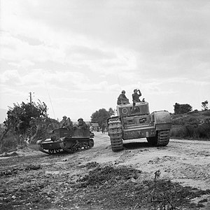 51st (Leeds Rifles) Royal Tank Regiment - A Universal Carrier and a Churchill tank of 51st Royal Tank Regiment during 6th Armoured Division's attack on the town of Pichon, Tunisia, 8 April 1943.