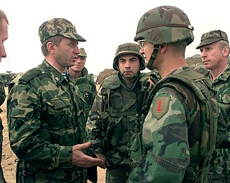 Bantz J. Craddock - First meeting between Craddock and Major General Valeri Evtoukovitich (left) commander of Russian Forces in Kosovo at Camp Bondsteel, Kosovo, on July 7, 1999.