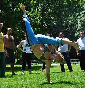 Capoeira in popular culture - capoeirista performing an Aú Batido