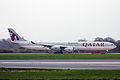 A7-AGD A340-642 Qatar Aws MAN 05APR14 (13641420665).jpg