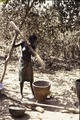 ASC Leiden - Coutinho Collection - doos-1 12 - Trip to Senegalese border from Candjambary, Guinea-Bissau - Woman pounding rice in village - 1974.tif