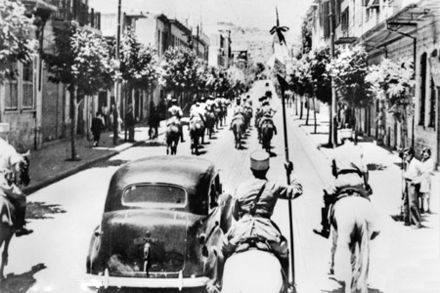 The fall of Damascus to the Allies, late June 1941. A car carrying Free French commanders General Georges Catroux and General Paul Louis Le Gentilhomme enters the city, escorted by French Circassian cavalry (Gardes Tcherkess). AWM 009747.jpg