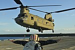 A U.S. Army CH-47 Chinook helicopter assigned to 3rd Battalion, 25th Aviation Regiment, 25th Combat Aviation Brigade, 25th Infantry Division, lands on the USS Tarawa (LHA-1), a Navy amphibious assault ship 130719-A-ZZ999-402.jpg