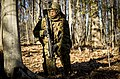 A U.S. Marine Corps officer with Bravo company, The Basic School (TBS), covers his sector during a patrol to ambush field exercise at Camp Barrett, Marine Corps Base Quantico, Va., March 13, 2014 140313-M-RO295-226.jpg