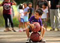 A child at a Shepherd of the Hills Children's Foundation home in San Antonio, Philippines, participates in a footrace during a community service project March 23, 2013 130323-N-VN372-321.jpg