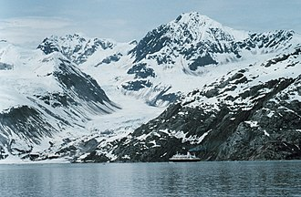 Glacier Bay Basin - A cruise ship dwarfed by the magnificence of the Glacier Bay.