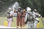 A member of the Marine Corps Air Station Beaufort fire department is washed as he goes through a decontamination center at the sight chemical spill at the training pool at Marine Corps Air Station Beaufort 130719-M-VR358-072.jpg