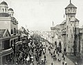 A procession forming up on the Pike on Pike Day at the 1904 World's Fair.jpg