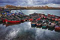 A view of small fishing boats sitting in from of the portuguese city in El jadida.jpg
