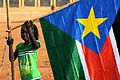 A young girl hangs the South Sudan flag (5925619011).jpg