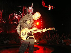Adam Clayton - Clayton performing at a Vertigo Tour concert in 2005.
