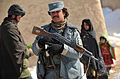 Afghan National Police and coalition special operations forces food handout 120207-N-UD522-181.jpg