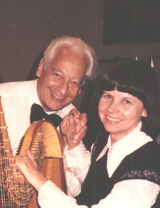 Rolf Agop - The conductor with a harpist in 1990