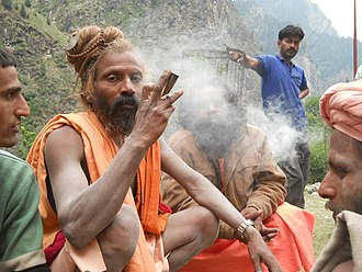 Aghori - An Aghori baba in Badrinath smoking hashish or cannabis from a chillum in 2011