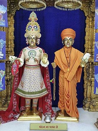 Gunatitanand Swami - The murtis of Purushottam Paramatma Bhagwan Swaminarayan (left) and Aksharbrahman Gunatitanand Swami (right)  are worshipped together as Akshar Purushottam Maharaj at the BAPS Shri Swaminarayan Mandir, Bochasan, Gujarat.