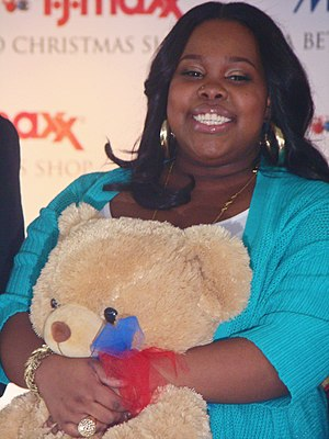 Amber Riley - Riley at a Toys for Tots event in December 2009