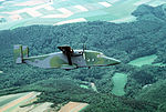 An air-to-air right side view of a 10th Military Airlift Squadron C-23 Sherpa aircraft DF-ST-89-06273.jpg