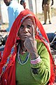 An elderly woman voter showing the ink-marked finger after casting vote at the polling booth of Palri Meena, Bagru, in Jaipur, during the Rajasthan Assembly Election, on December 01, 2013.jpg