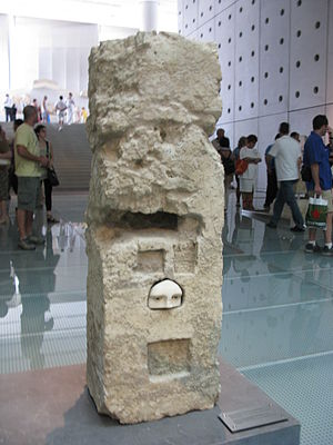 Votive offering - Part of a female face with inlaid eyes, Ancient Greek Votive offering, 4th century BC, probably by Praxias, set in a niche of a pillar in the sanctuary of Asclepios in Athens, Acropolis Museum, Athens