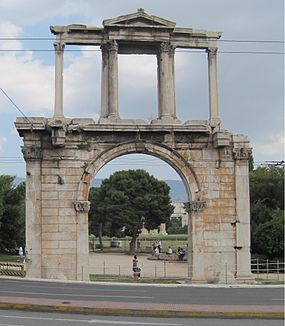 The Arch of Hadrian and the Olympeion looking southeast on Lysicrates street.